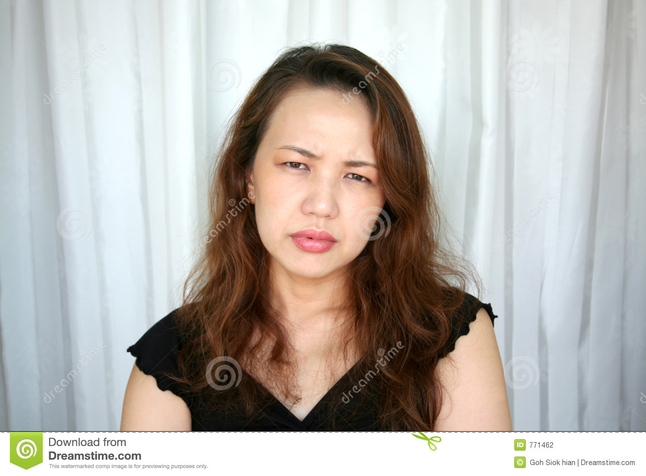 Woman frowning