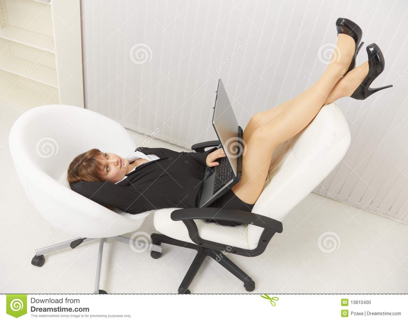 Woman Funny Located In Office Chairs With Laptop Stock