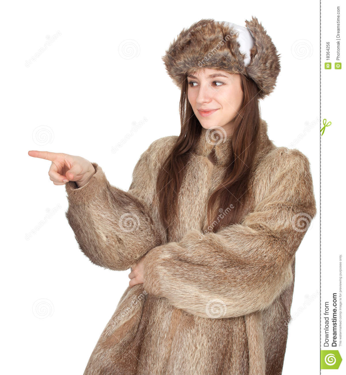 Woman In A Fur Coat And Hat Pointing Royalty Free Stock Image ...