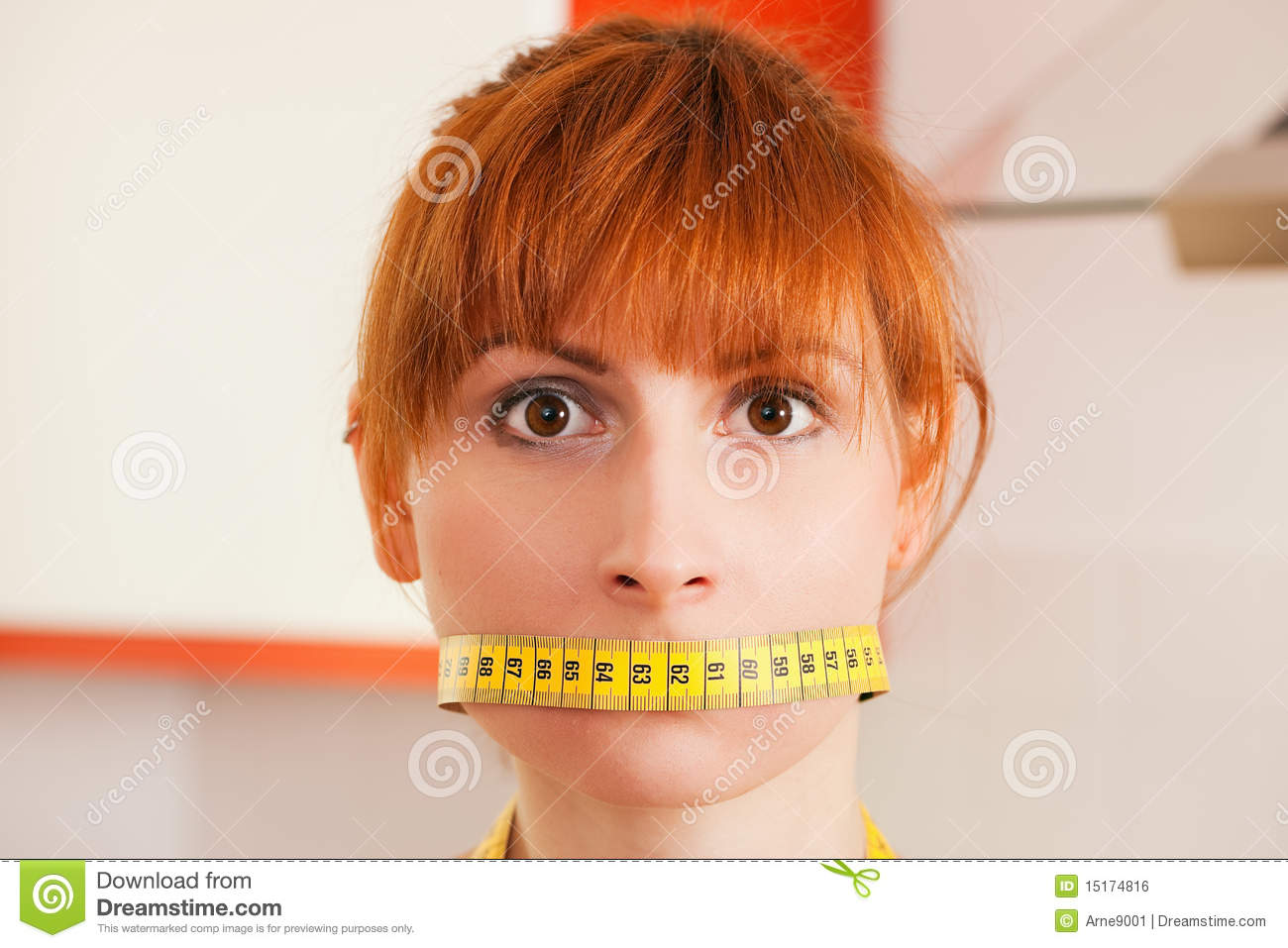 Woman Gagged By A Tape Measure Royalty Free Stock Image - Image