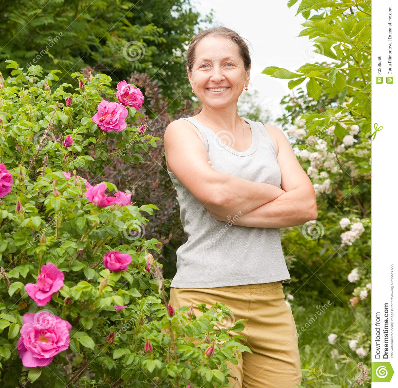 ae815bf8 Woman in garden stock photo. Image of human, plant, mature - 20369566