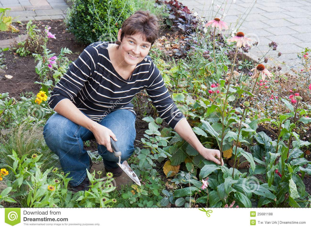 A woman gardening in the garden of her house