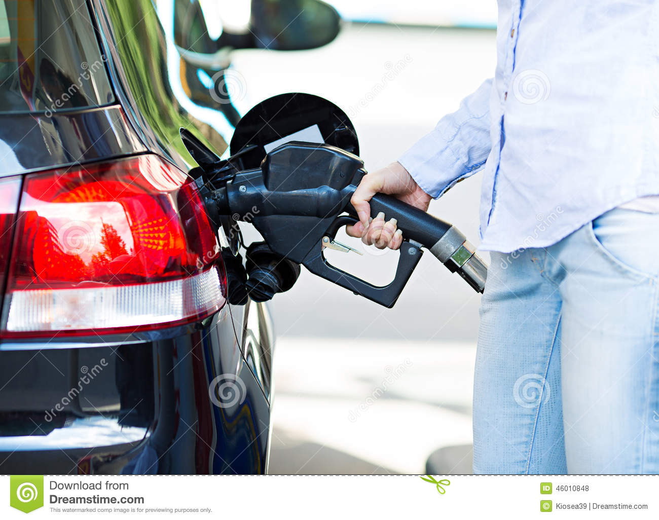 Woman at gas station filling up her car stock photo for Max motor dreams cost