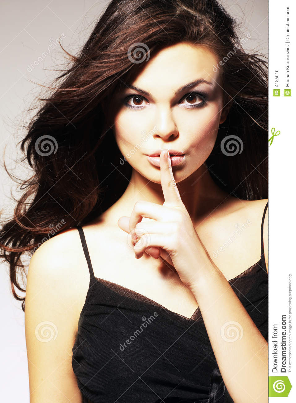 Woman Gesturing for Quiet or Shushing