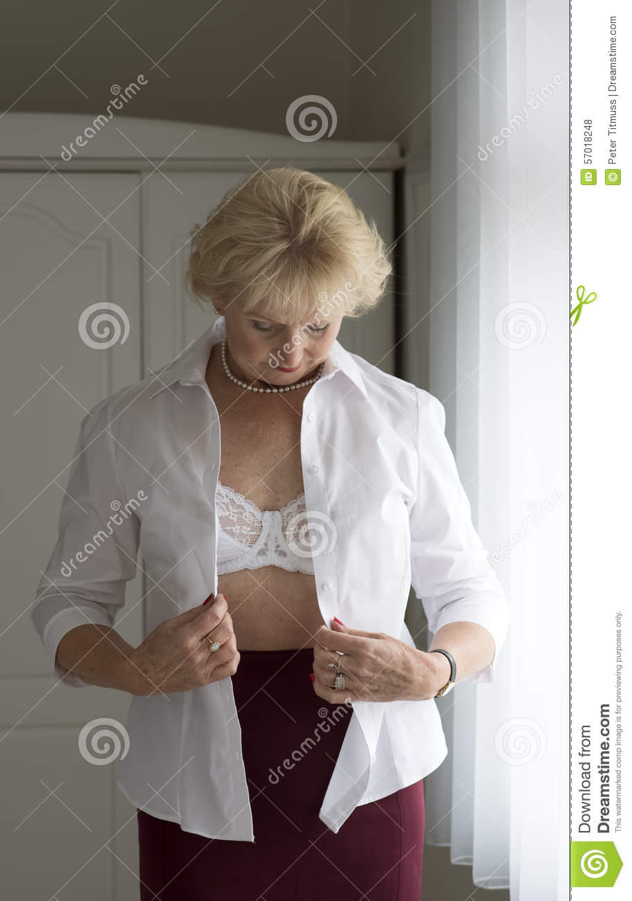 woman getting dressed stock photo image of sixty putting