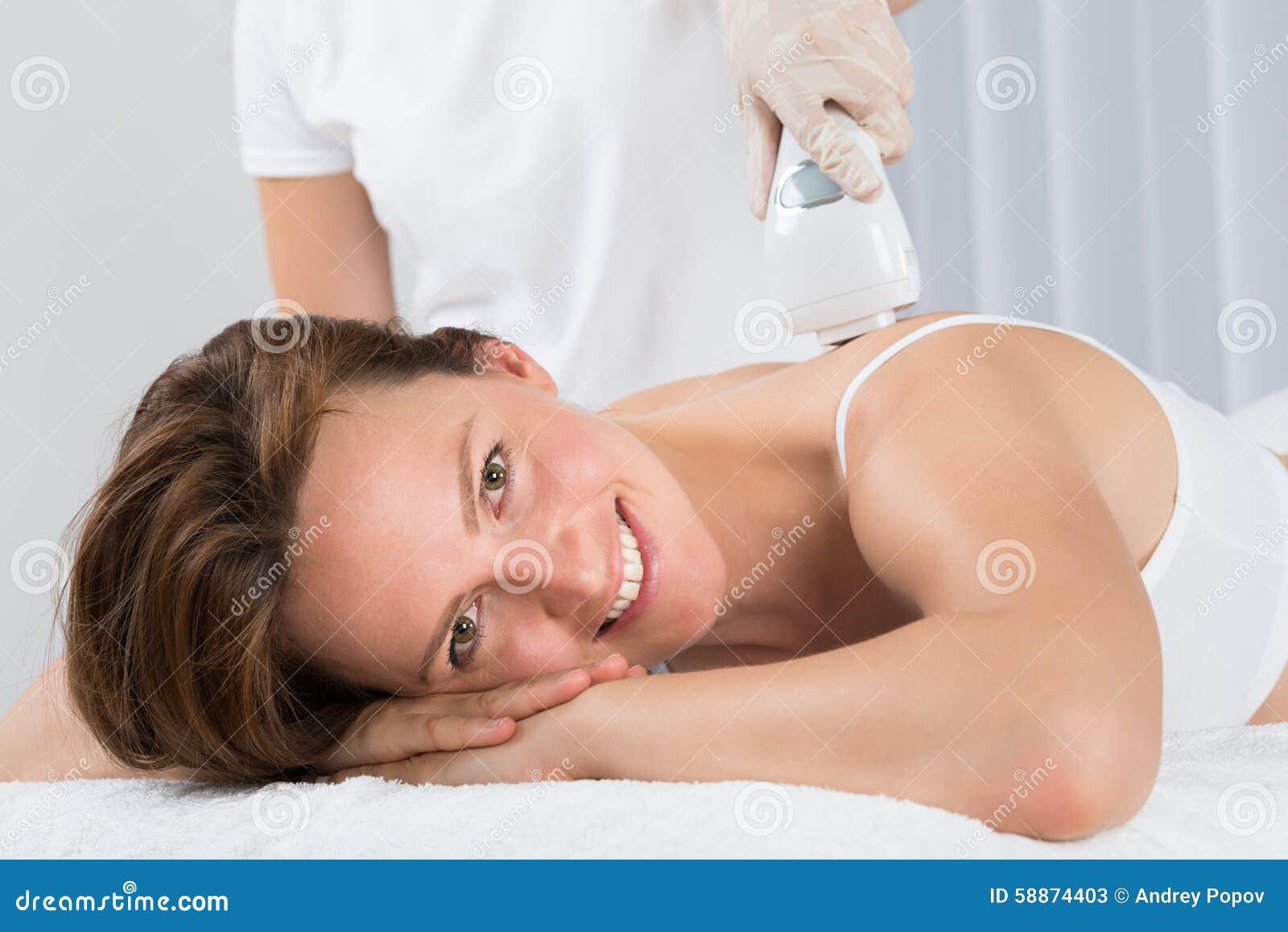 woman getting epilation laser treatment stock photo image 58874403. Black Bedroom Furniture Sets. Home Design Ideas