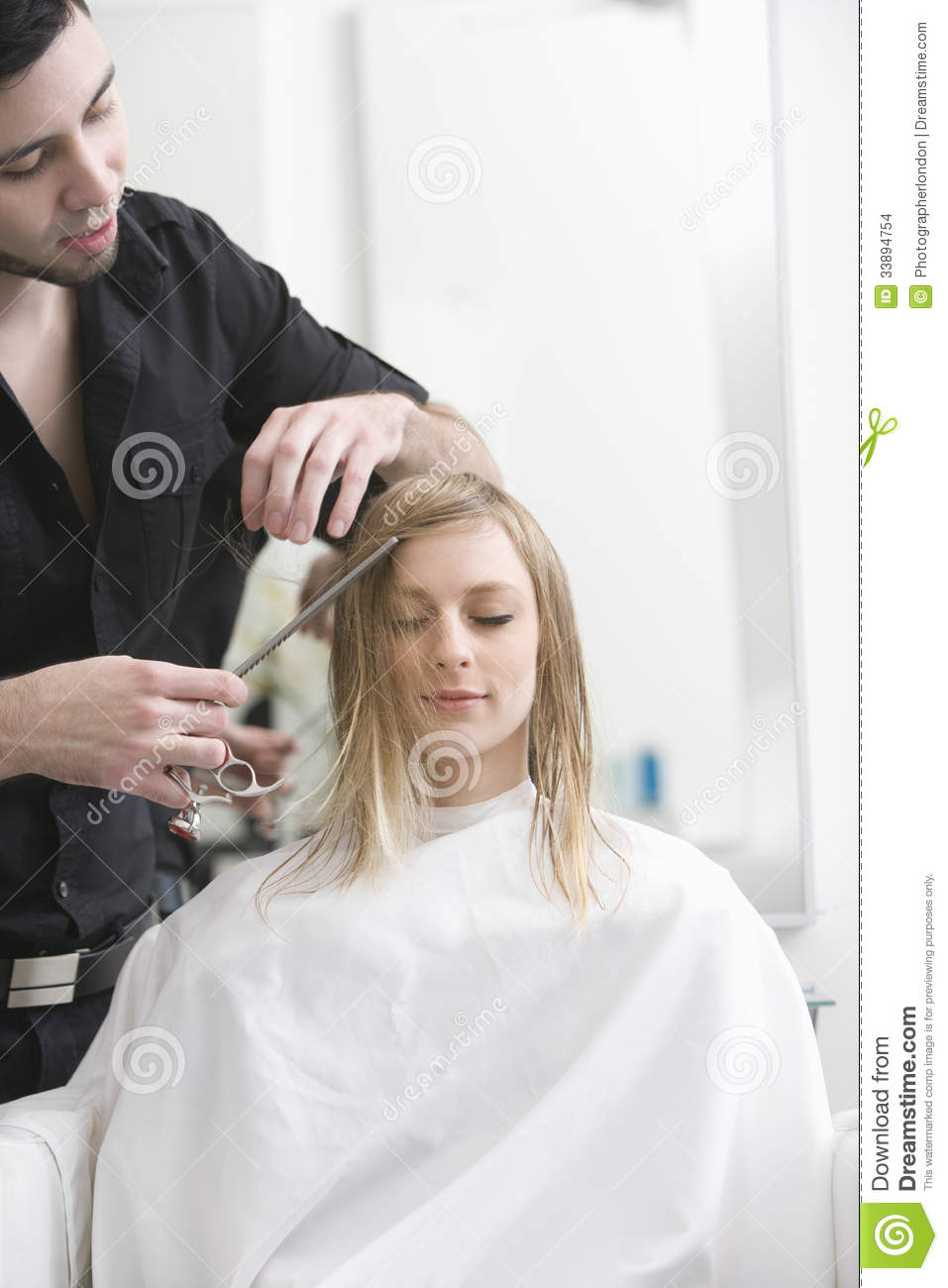 Woman Getting Haircut From Hairdresser At Salon Stock ...