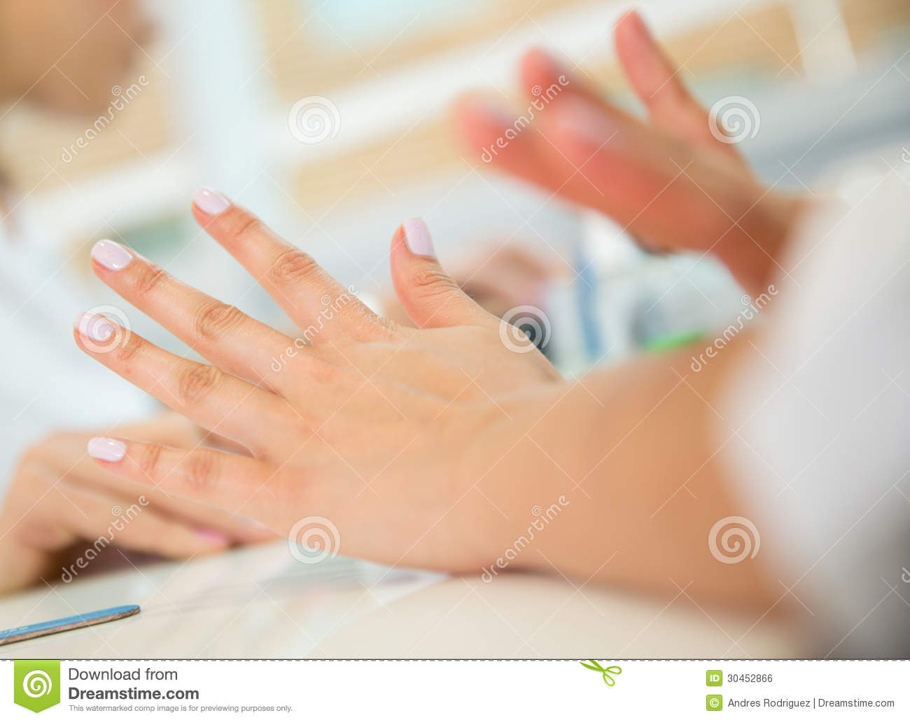 Woman getting her nails done stock photo image 30452866 for At nail salon