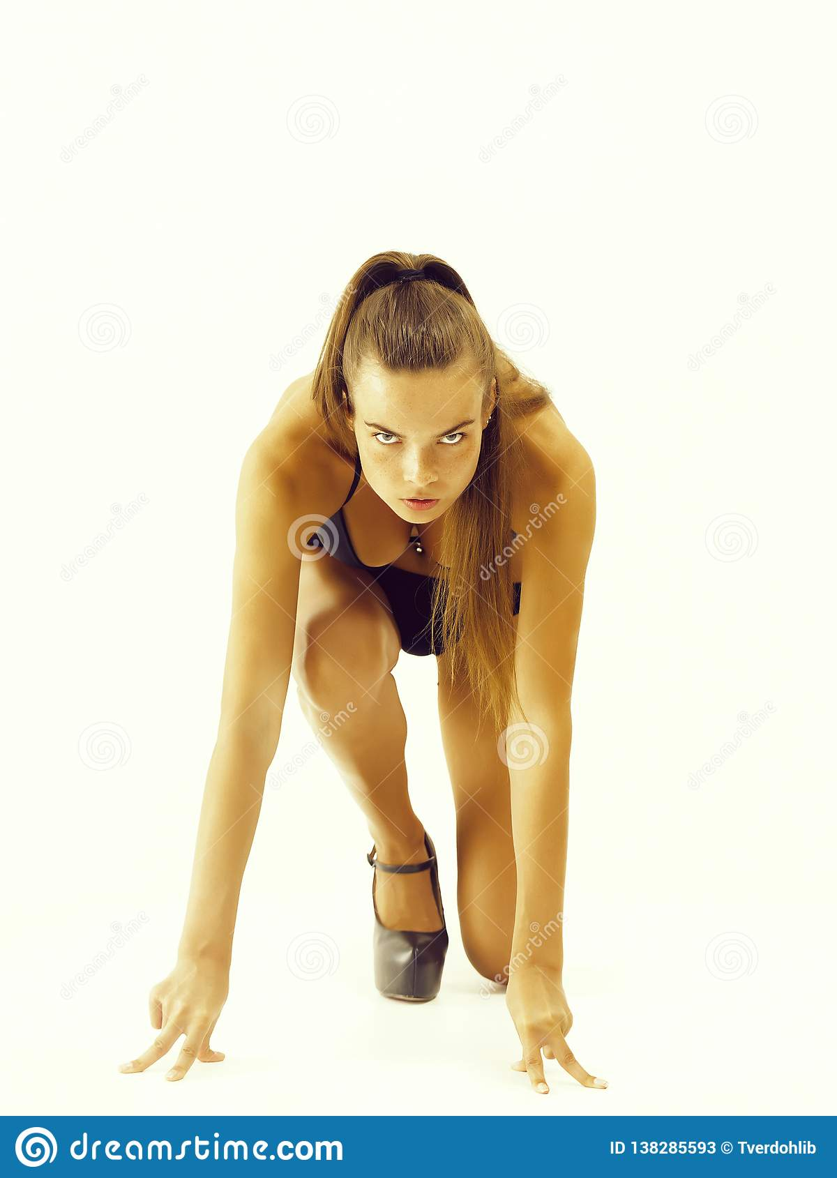 woman getting ready to run in starting position
