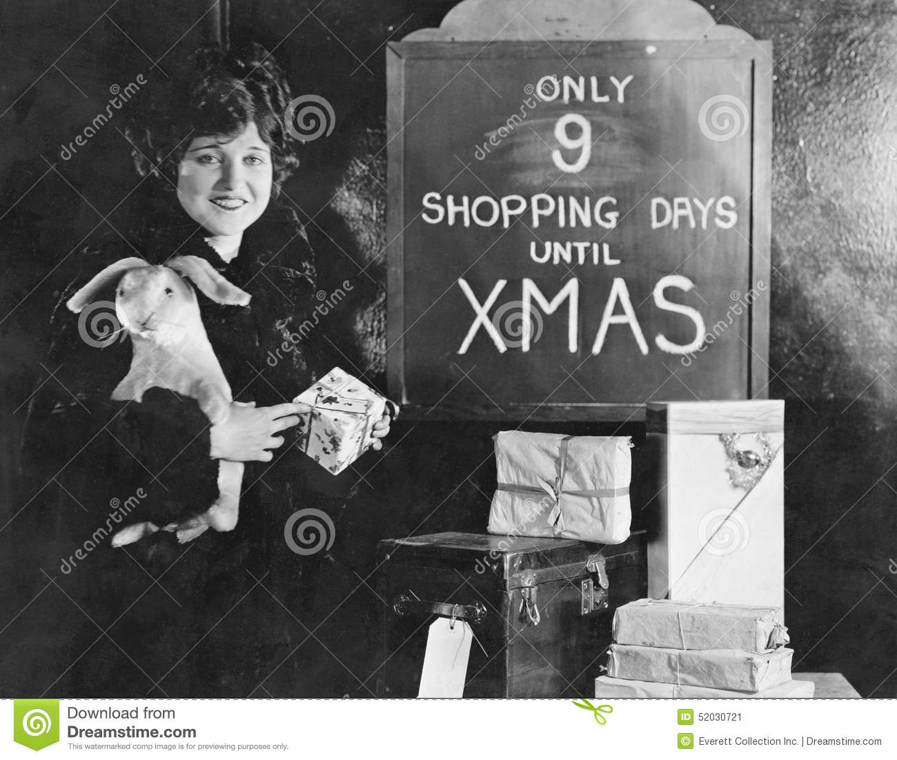 woman with gifts and sign with number of shopping days until christmas - How Much Longer Until Christmas