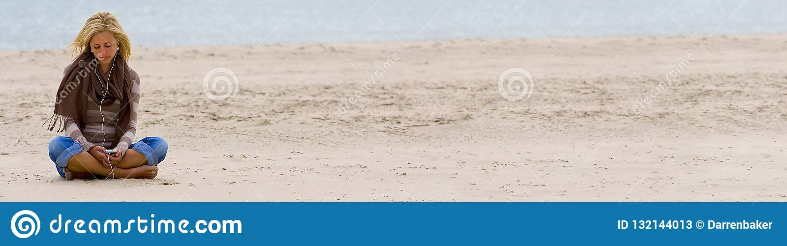 Woman Girl on Beach Listening to Music on Smart Phone