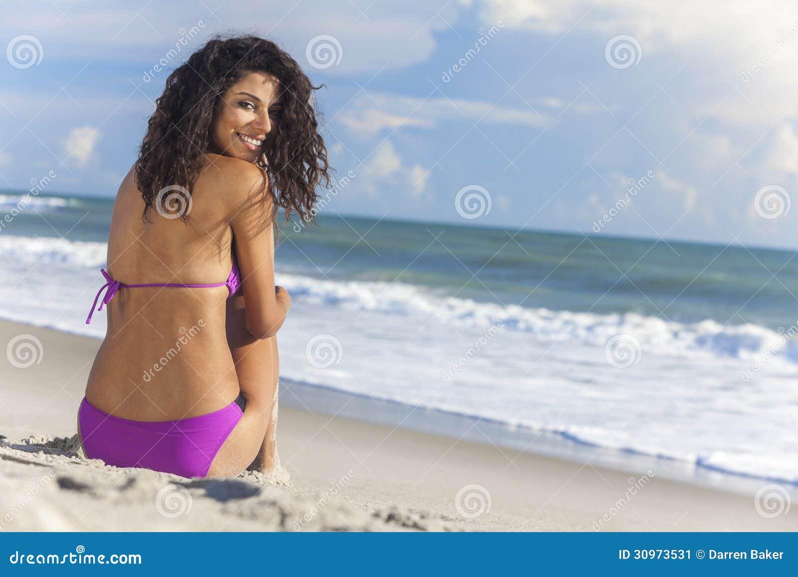 Bikini girl sitting