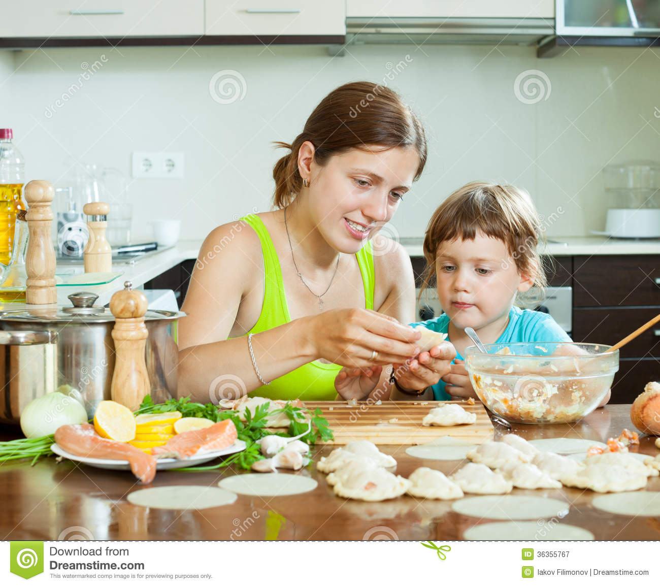 Women Kitchen: Happy Women Cooking Dumplings Royalty-Free Stock Photo