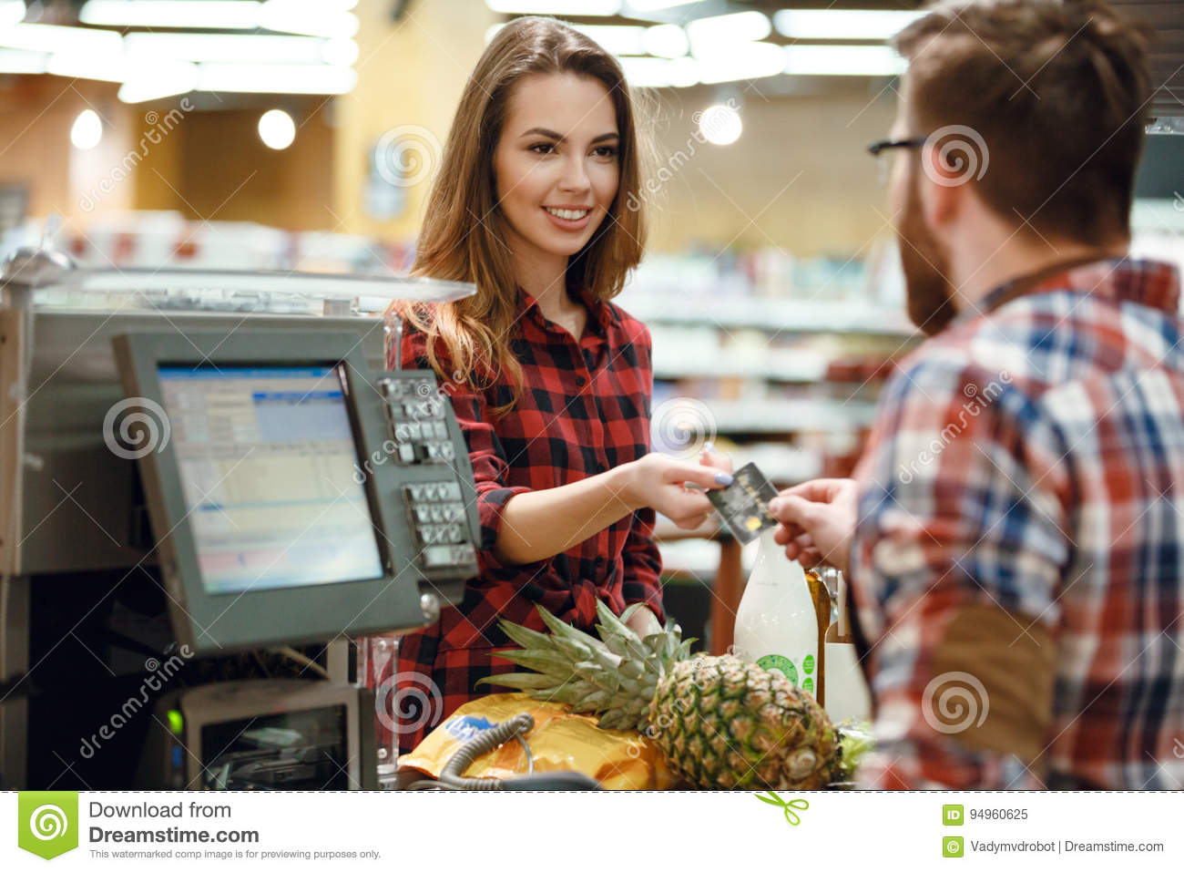 Woman Gives Credit Card To Cashier Man Picture Of Young Women