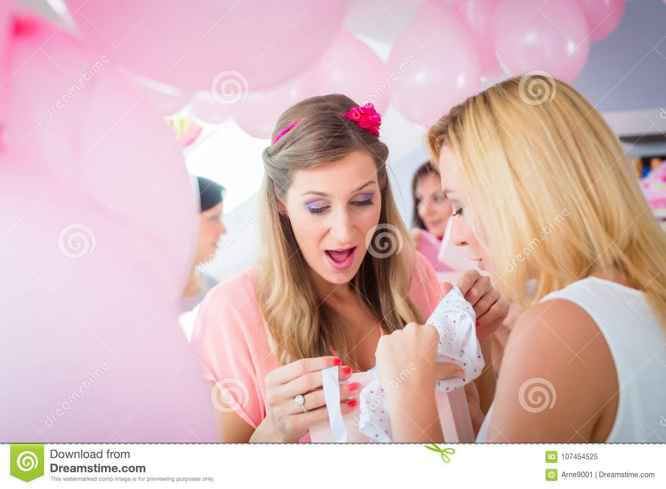 Woman Giving Gift To Pregnant Friend On Baby Shower Stock ...