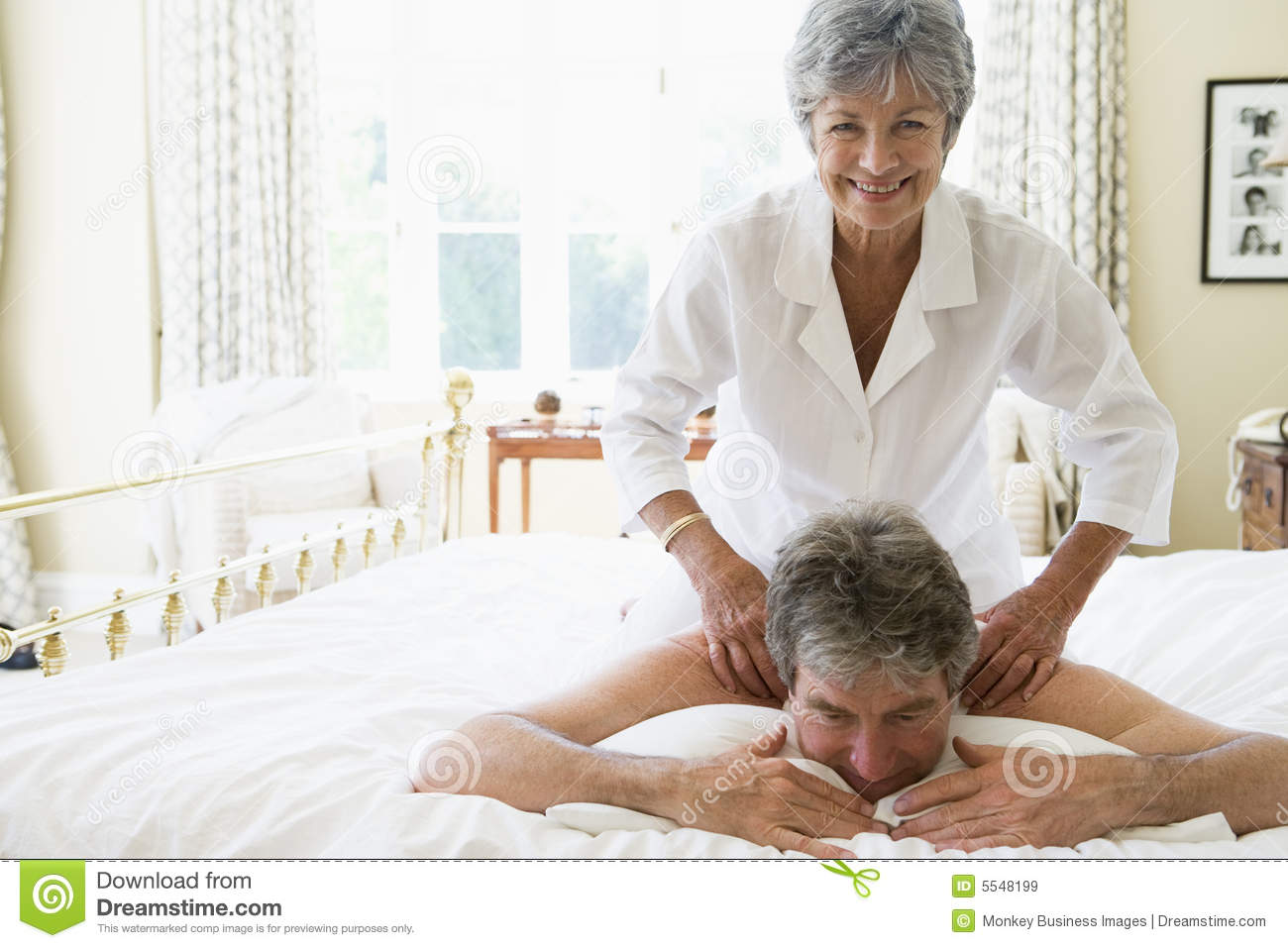 Woman Giving Man Massage In Bedroom Smiling Royalty Free ...