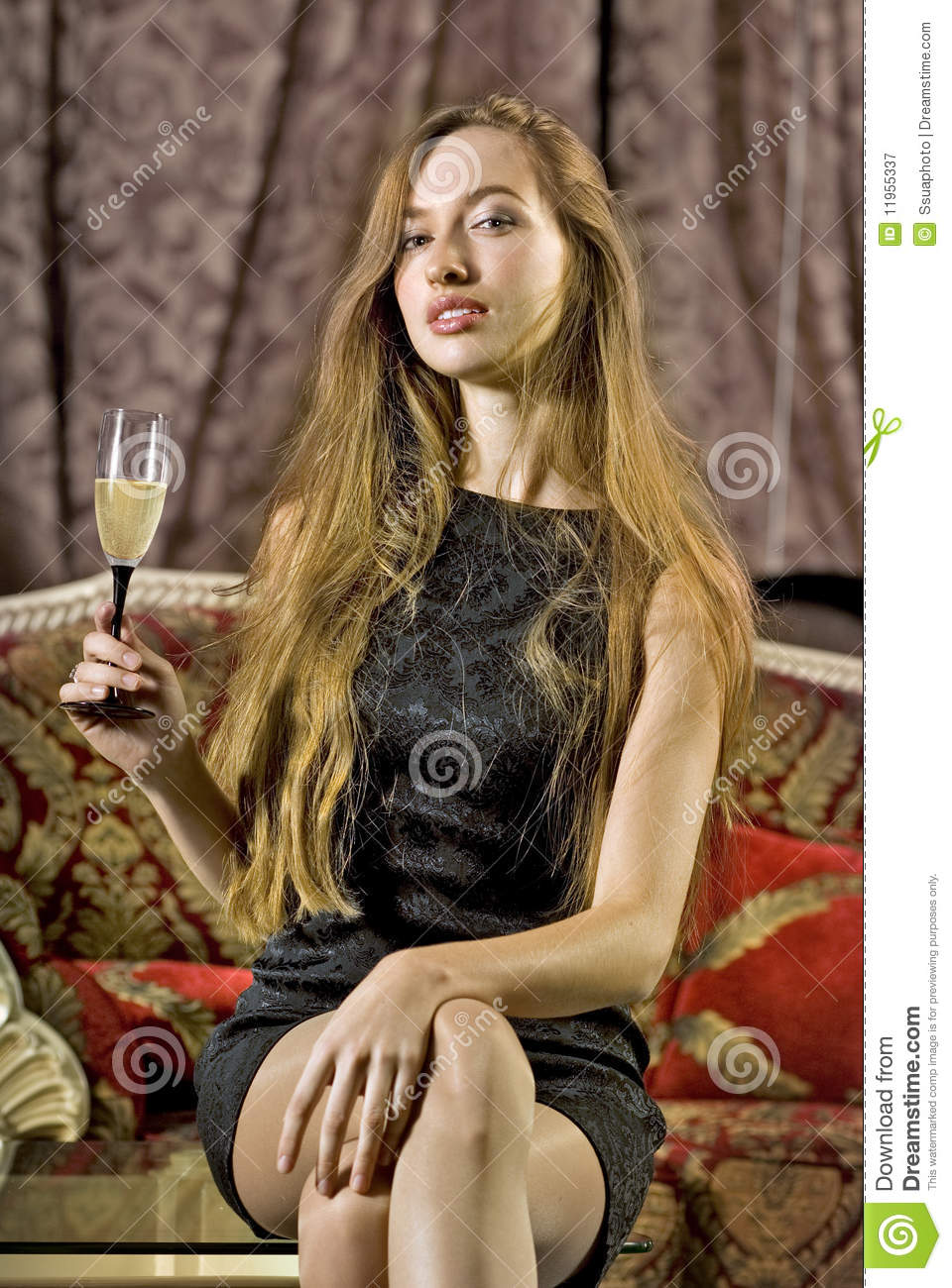 Woman with glass of brut