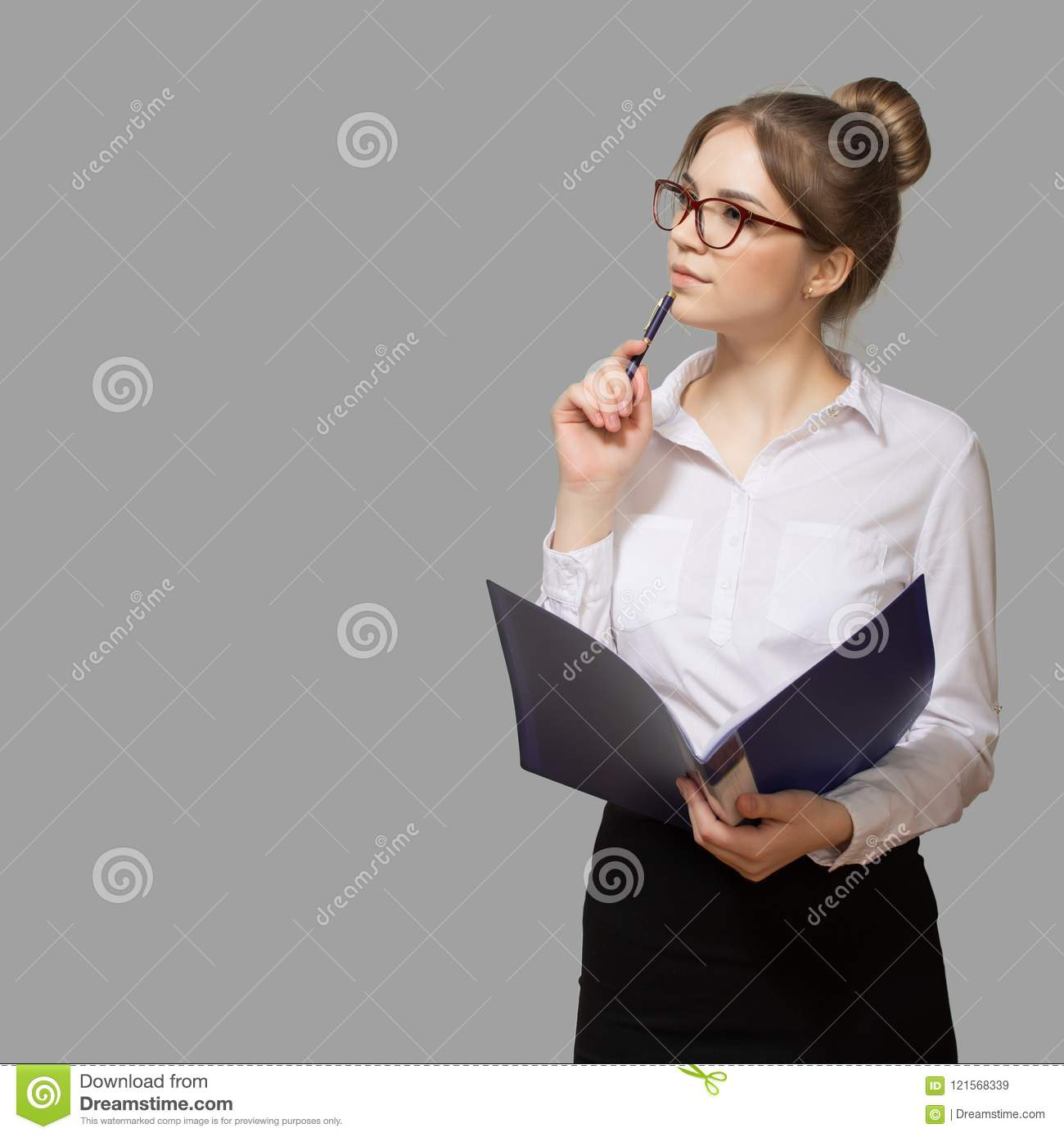 Woman with a folder in glasses