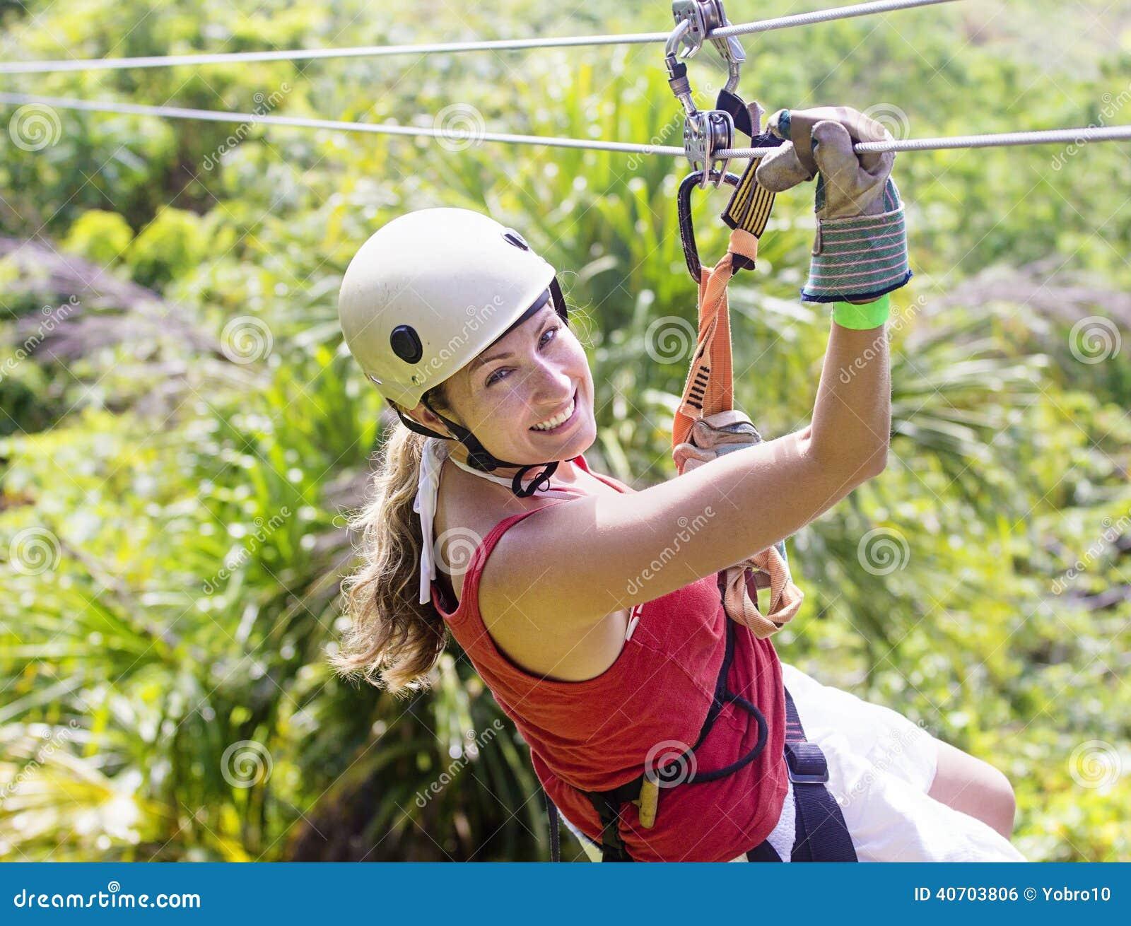 Woman Going On A Jungle Zipline Adventure Stock Photo
