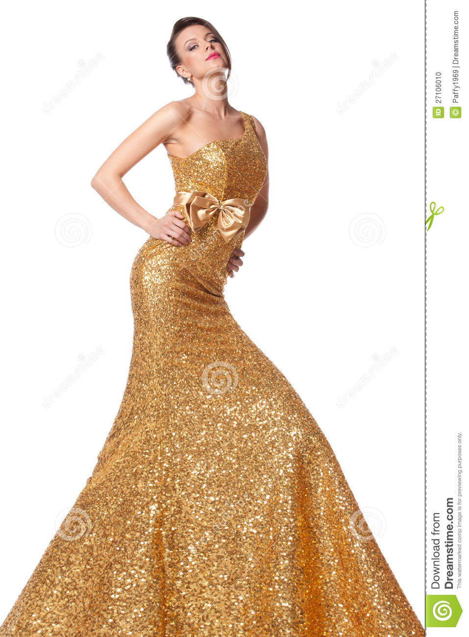 Young female posing in long golden everning fress over white ...