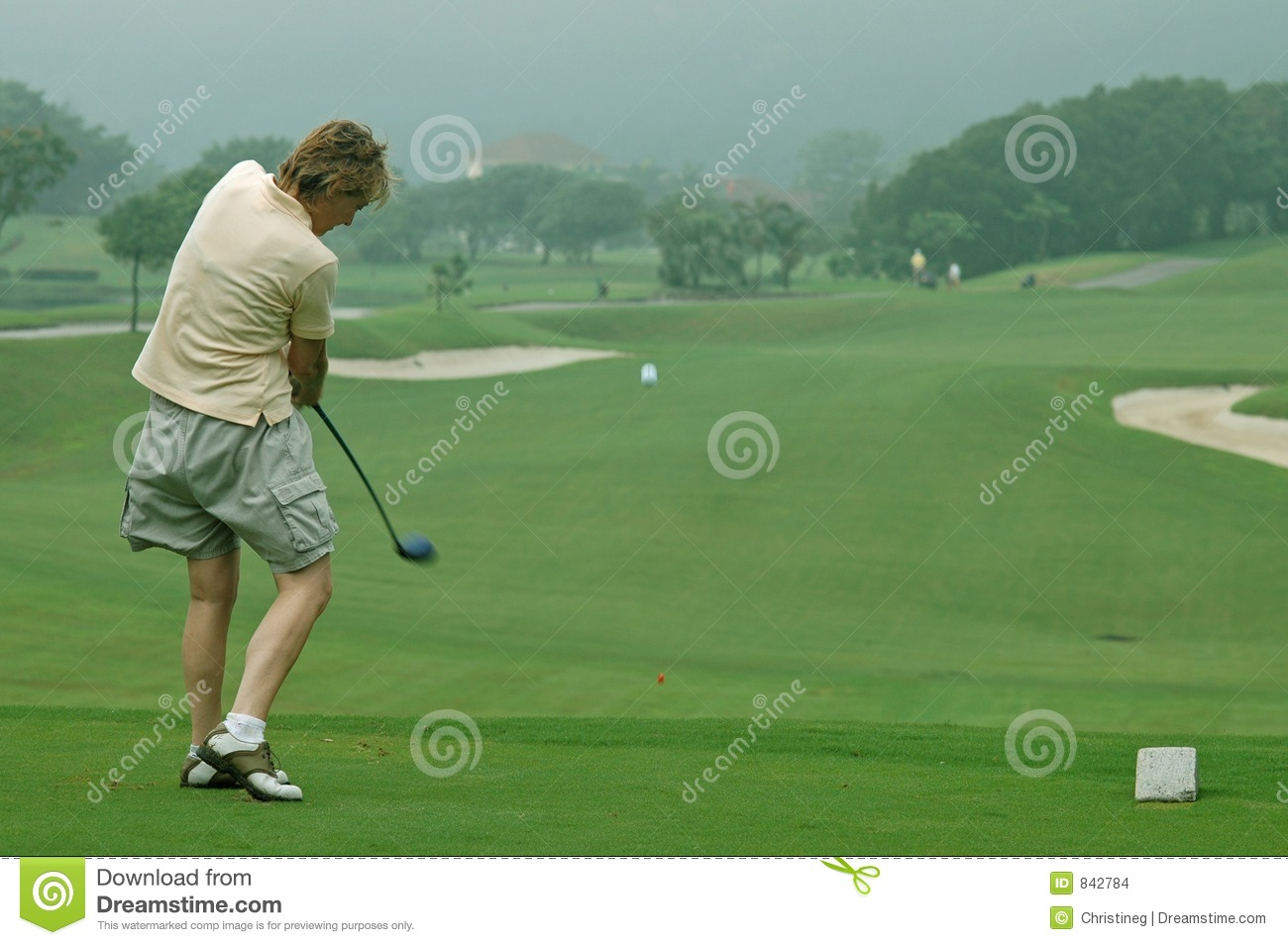 Woman golfer driving off the tee