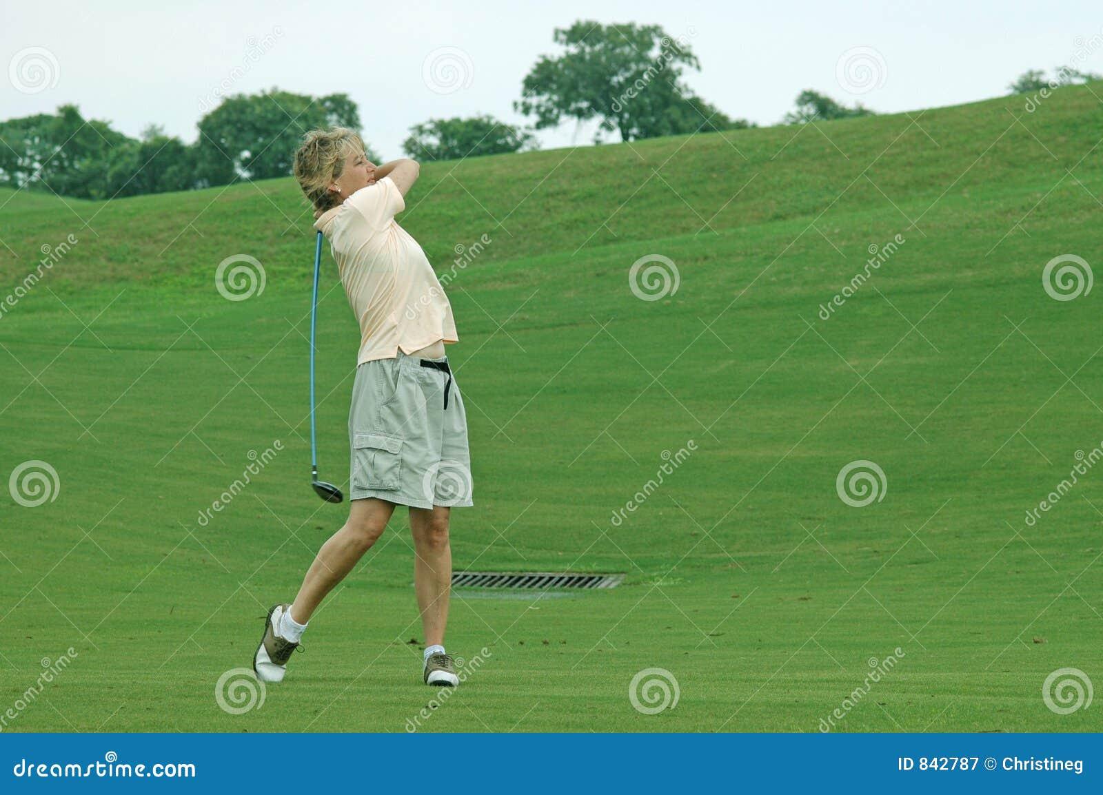 Woman golfer taking the shot