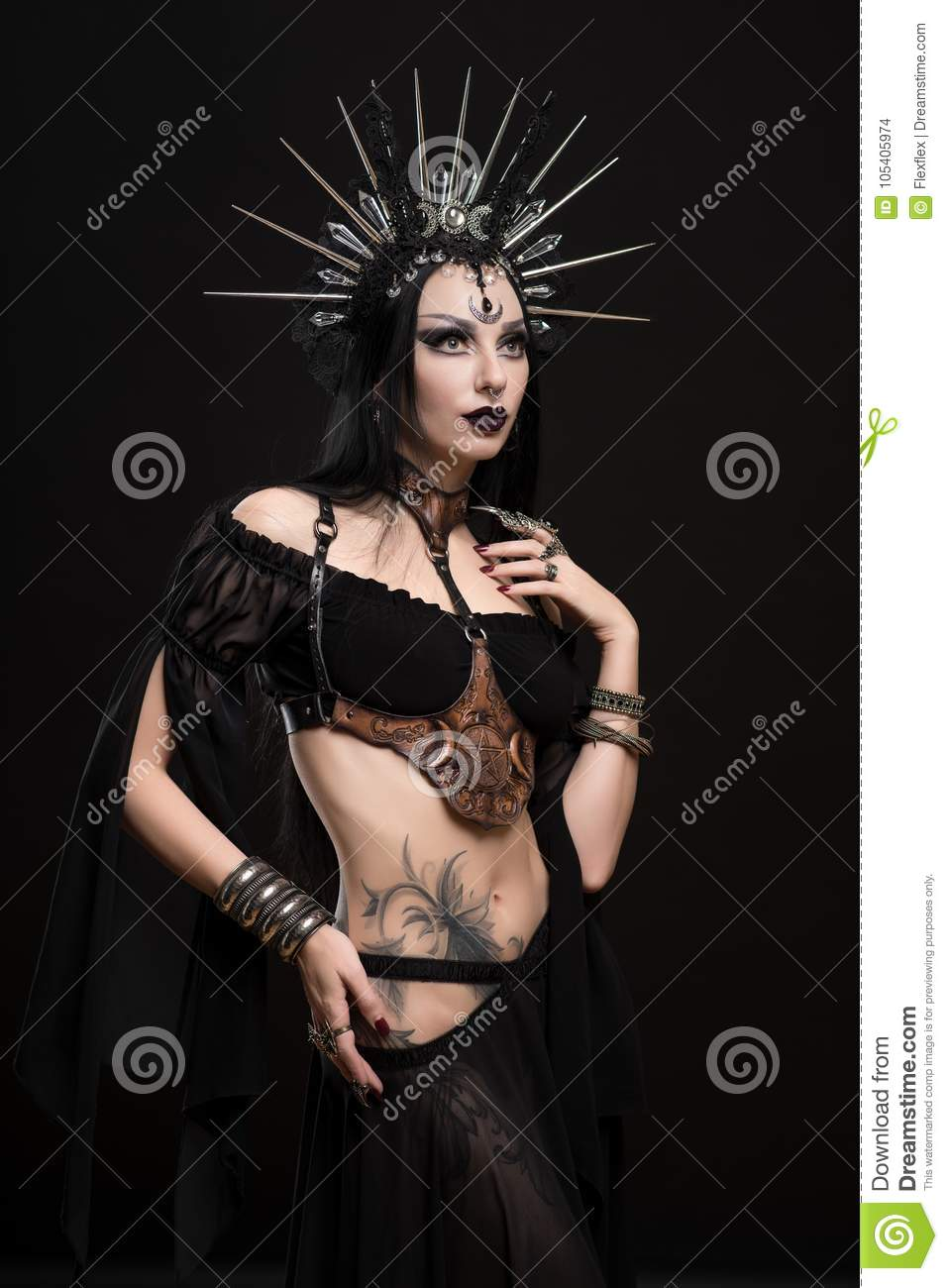 Woman in gothic suit and silver crown