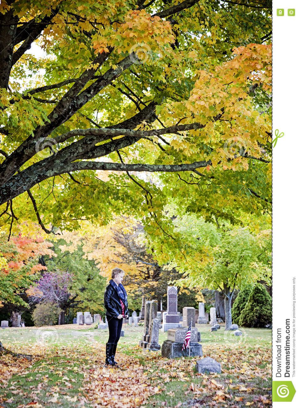 Woman at grave in cemetery