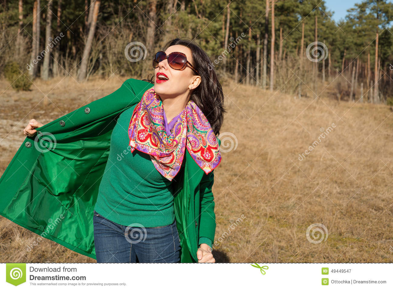 Woman in green coat walks on nature stock photo image for Cheerful nature