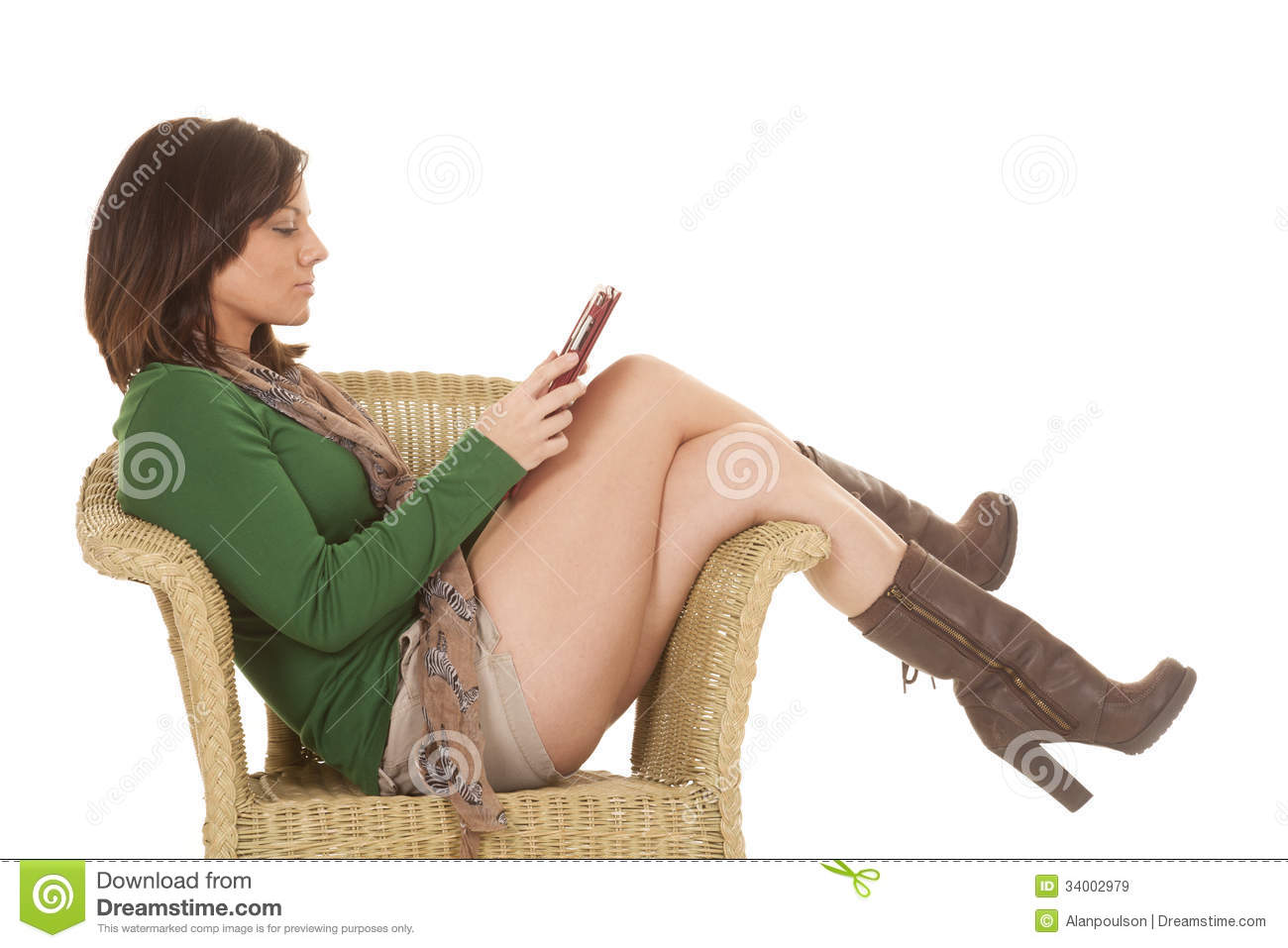 Woman Green Shirt Legs Tablet Chair Side Stock Image