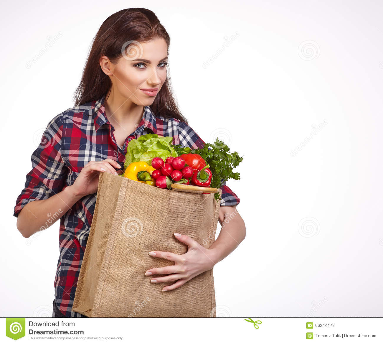 Woman with groceries shopping bag full of healthy vegetables smi