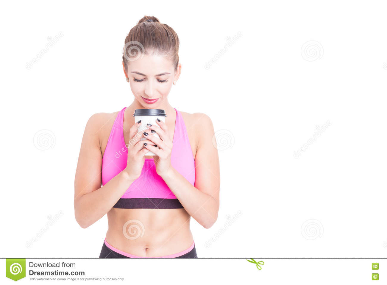 Woman at gym holding coffee cup on break