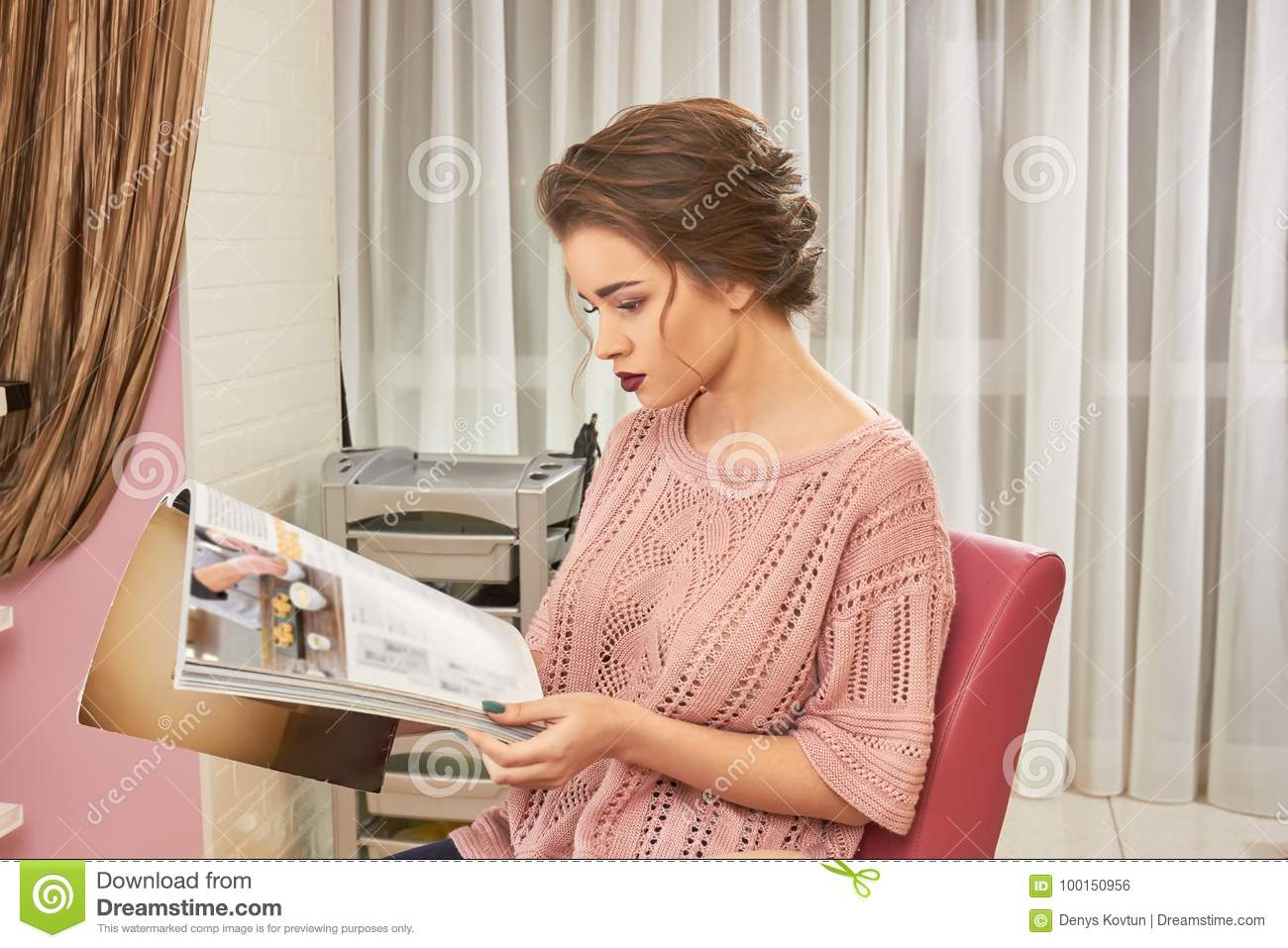 Woman in hair salon magazine stock photo image of for Reading beauty salon