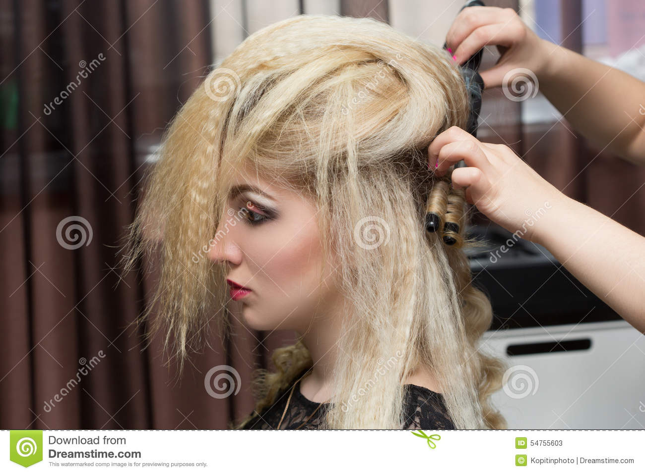 Woman hairdresser do hairstyle girl in beauty stock photo for Salon younga