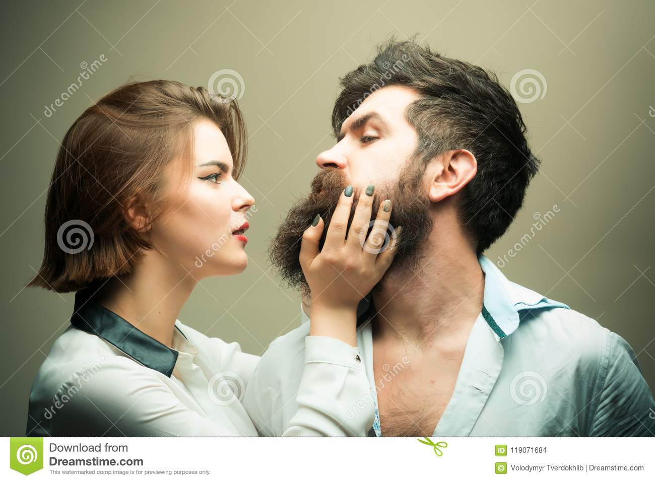 Woman Hairdresser Making Shape Of Beard Touches Man With Long