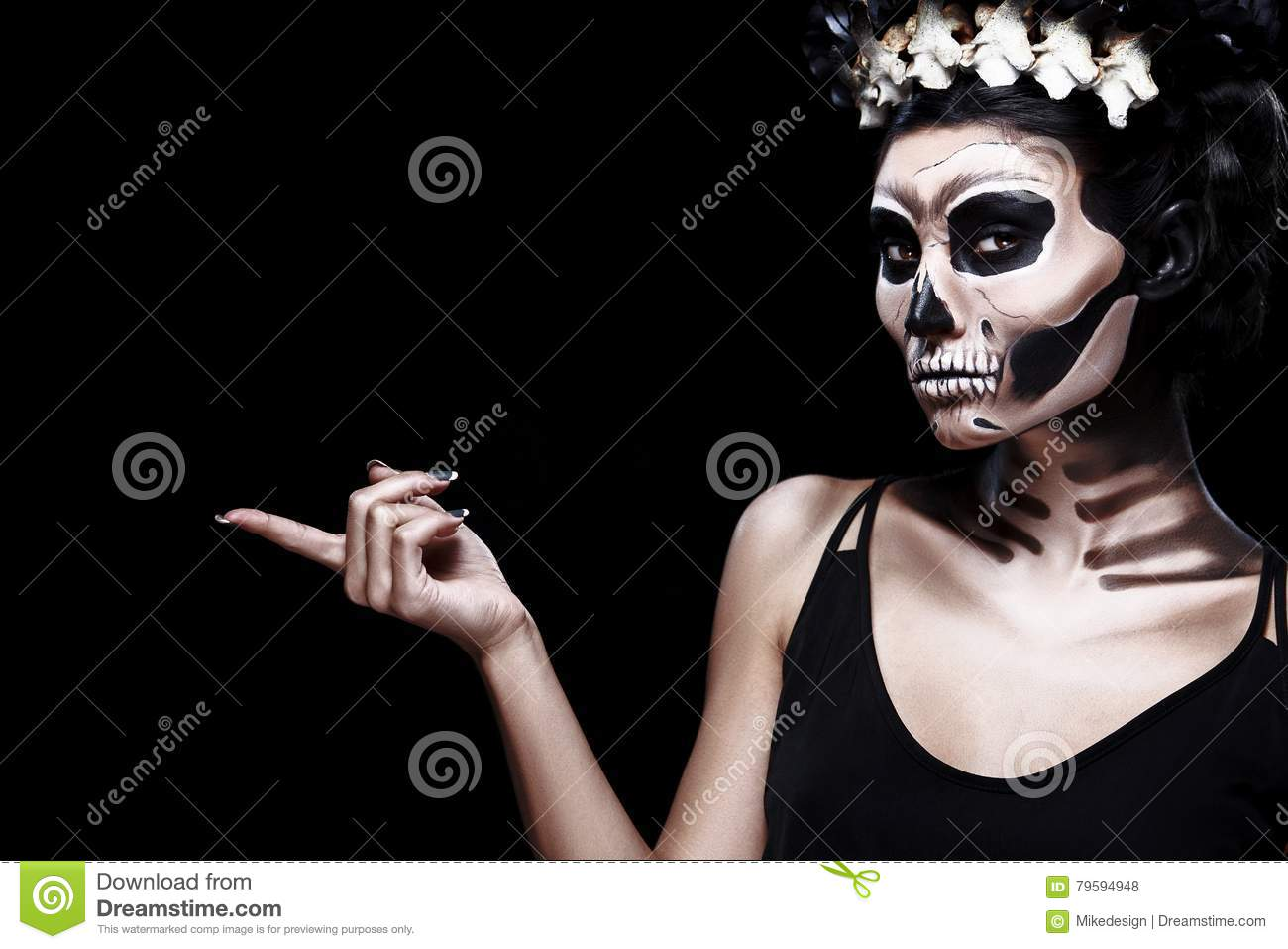 Woman in Halloween costume of Frida Kahlo with copy space. Skeleton or skull makeup.
