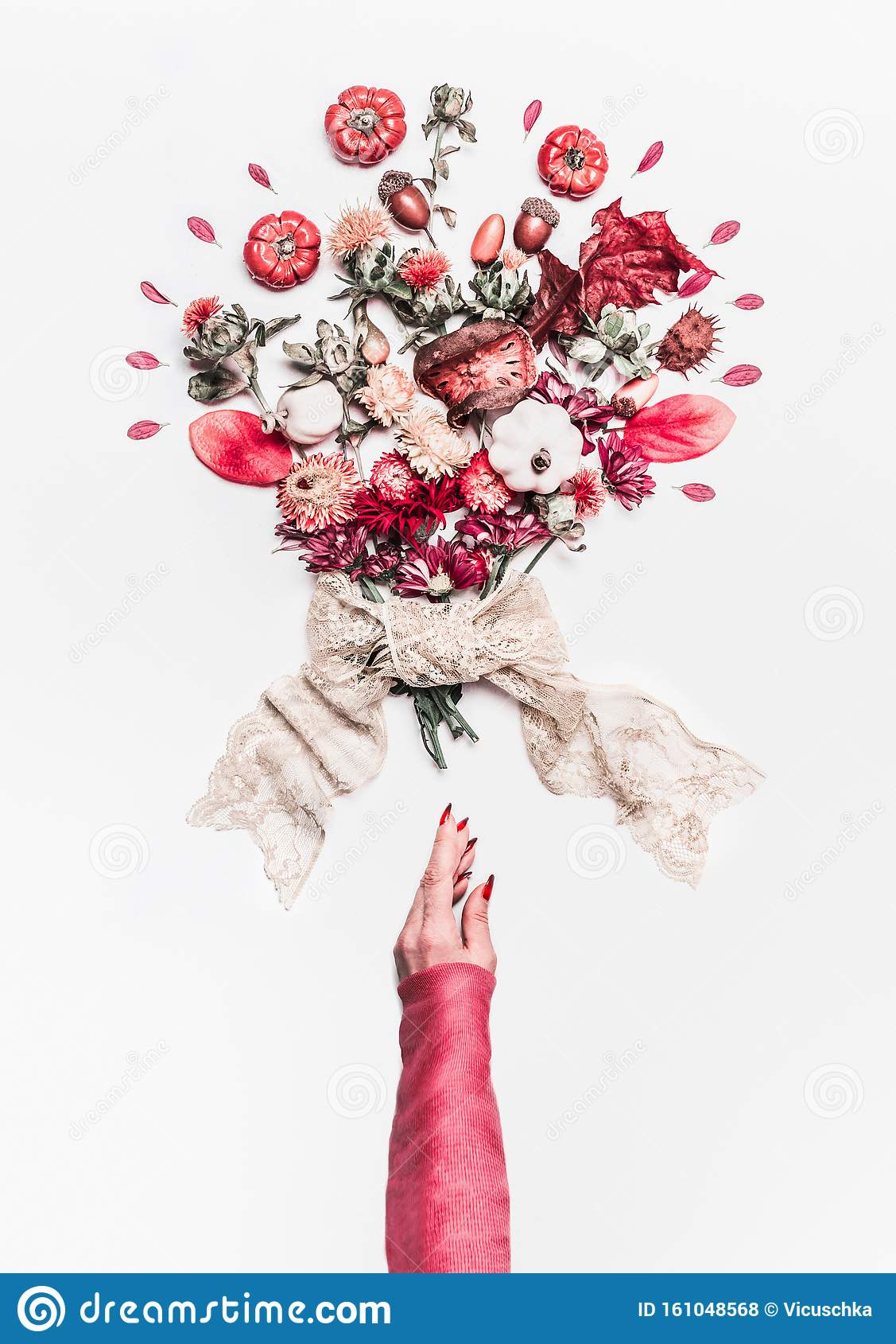 Woman Hand And Autumn Flowers And Decoration Arrangement With
