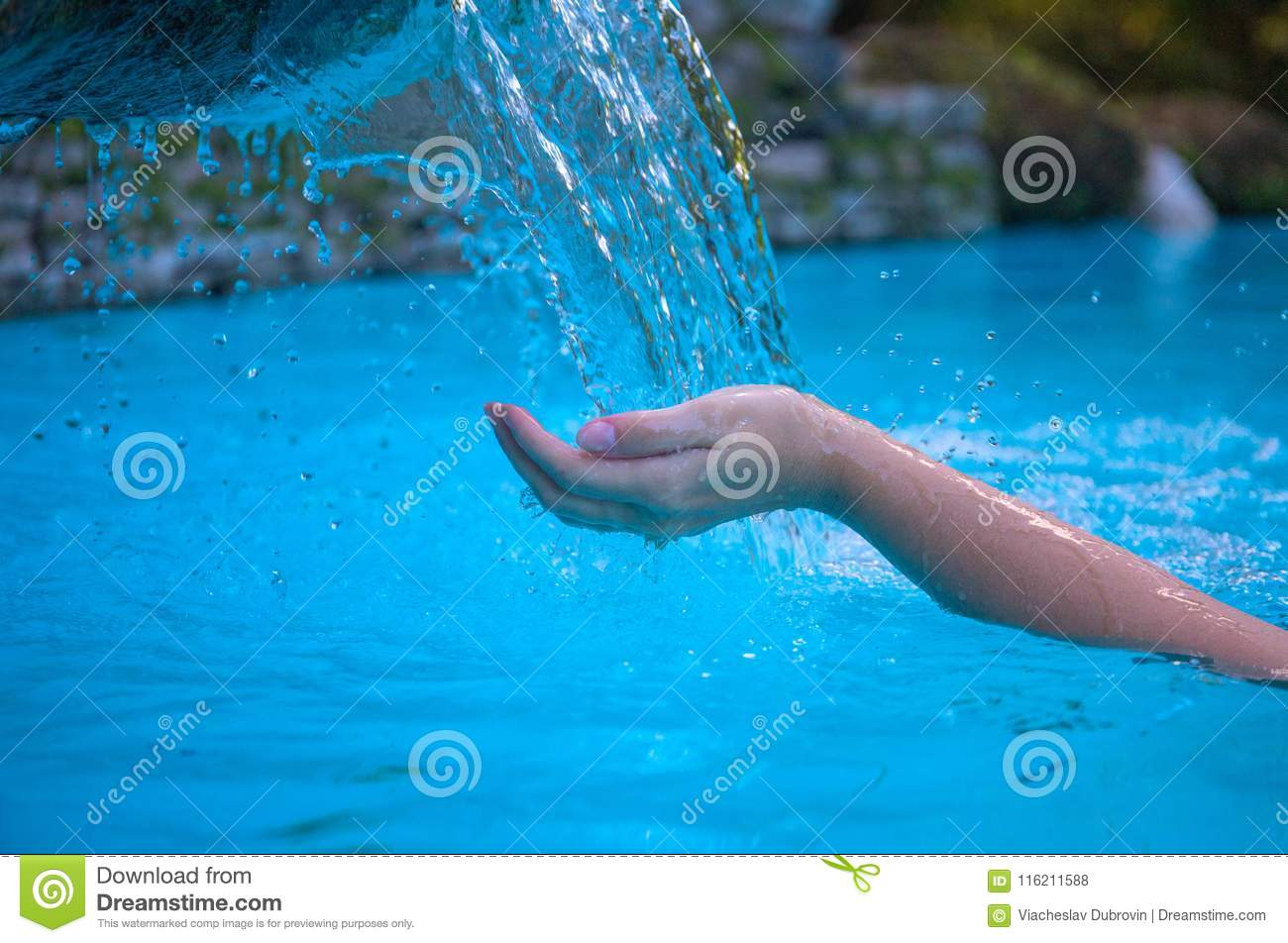 Woman hand and blue water. Cool water stream and hands. Fresh water current. Woman hands in clean flow.