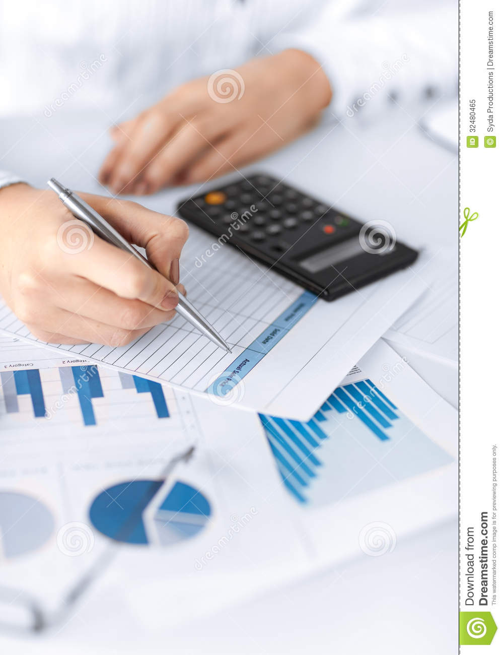 Woman Hand With Calculator And Papers Royalty Free Stock