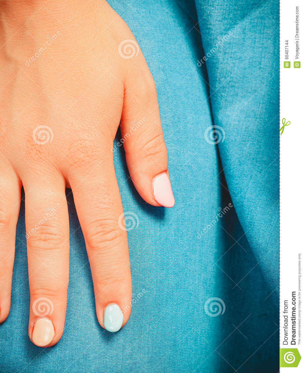 Woman Hand With Color Nail Polish. Manicure. Stock Photo
