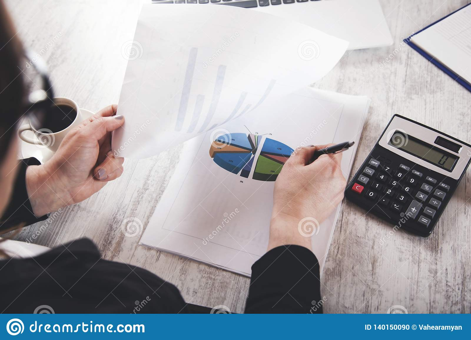Woman hand graph with calculator