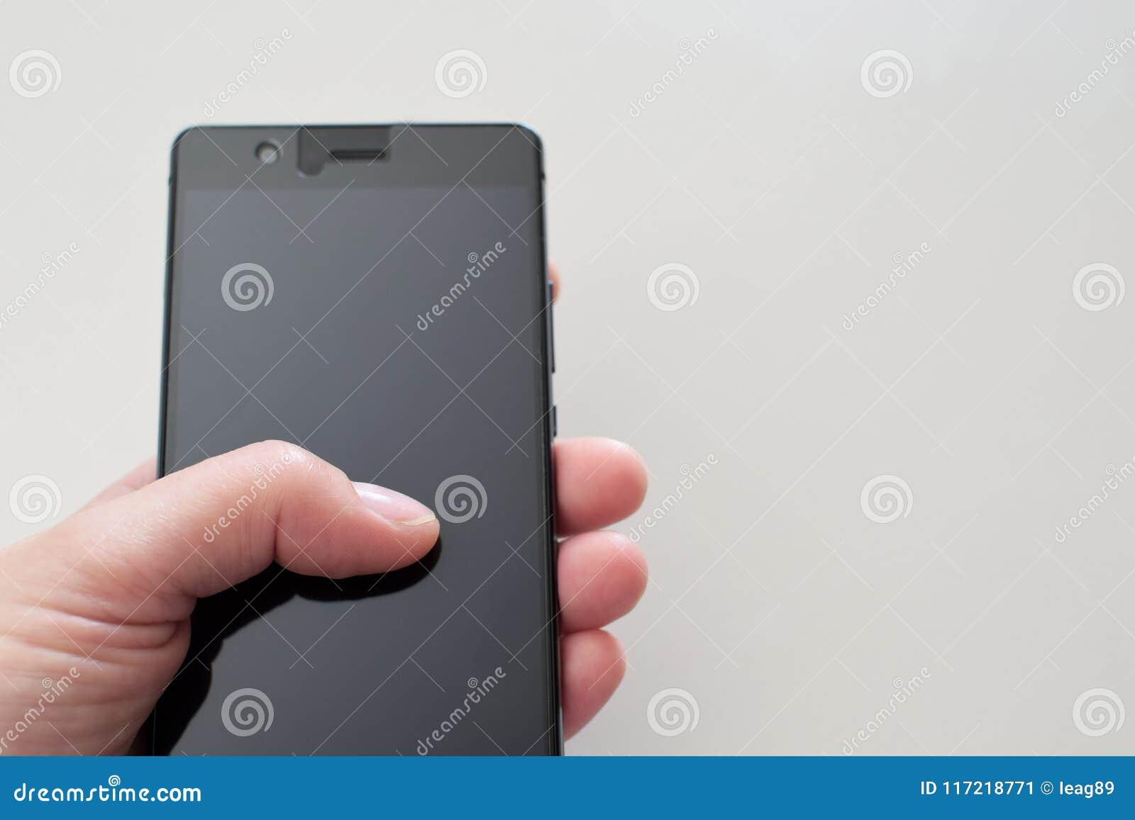 Woman hand holding black smartphone
