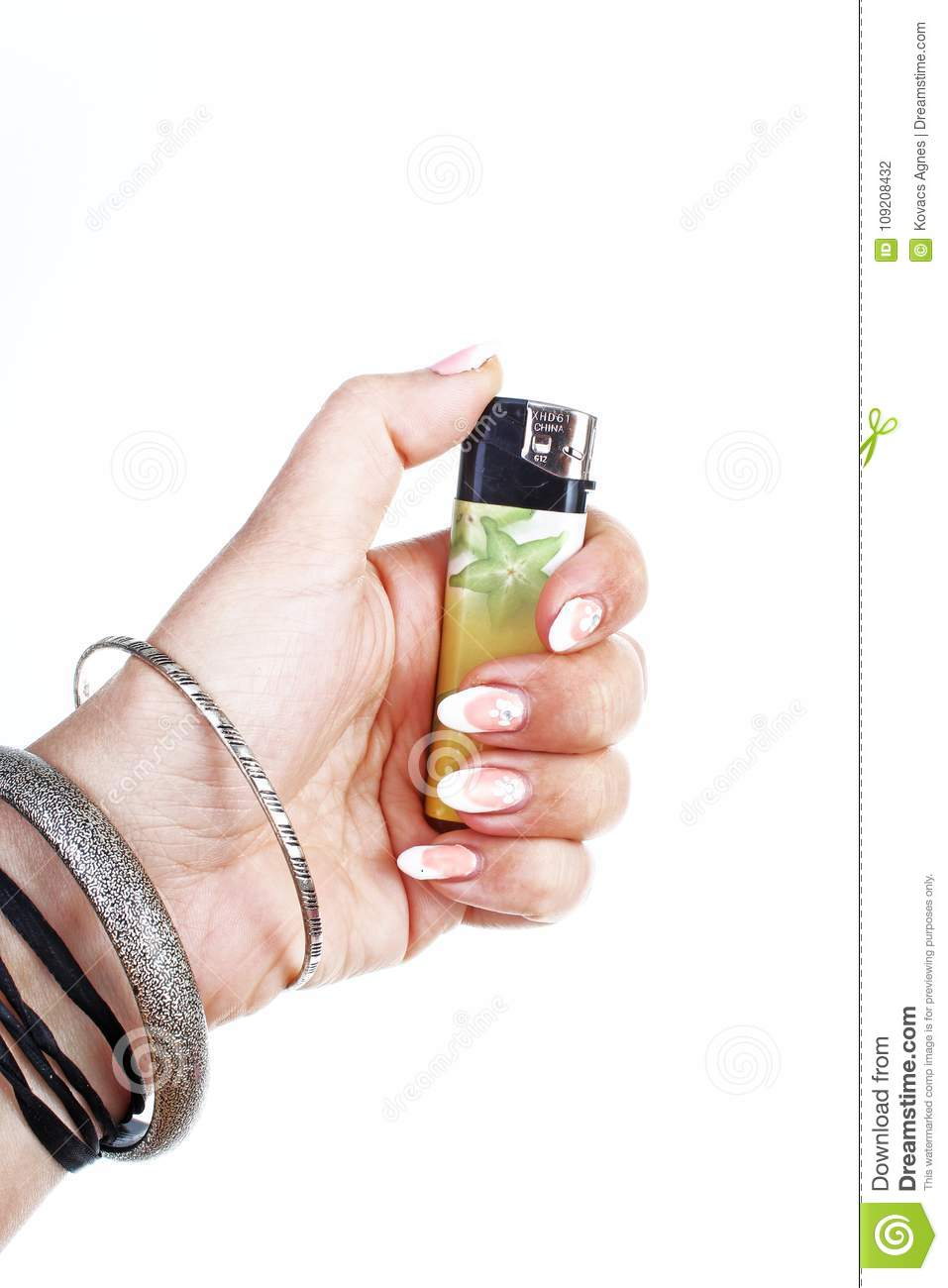 Woman Hand Holding Lighter On Isolated White Cutout