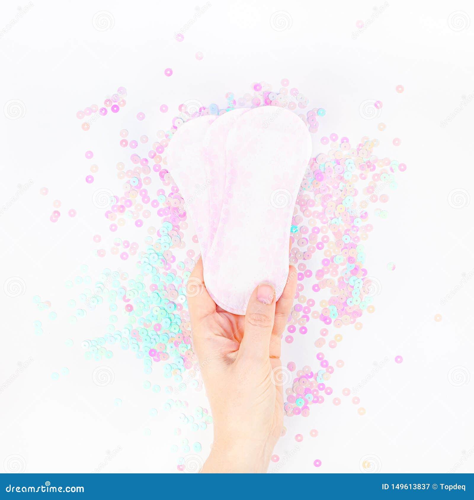 Woman hand holding daily sanitary napkins
