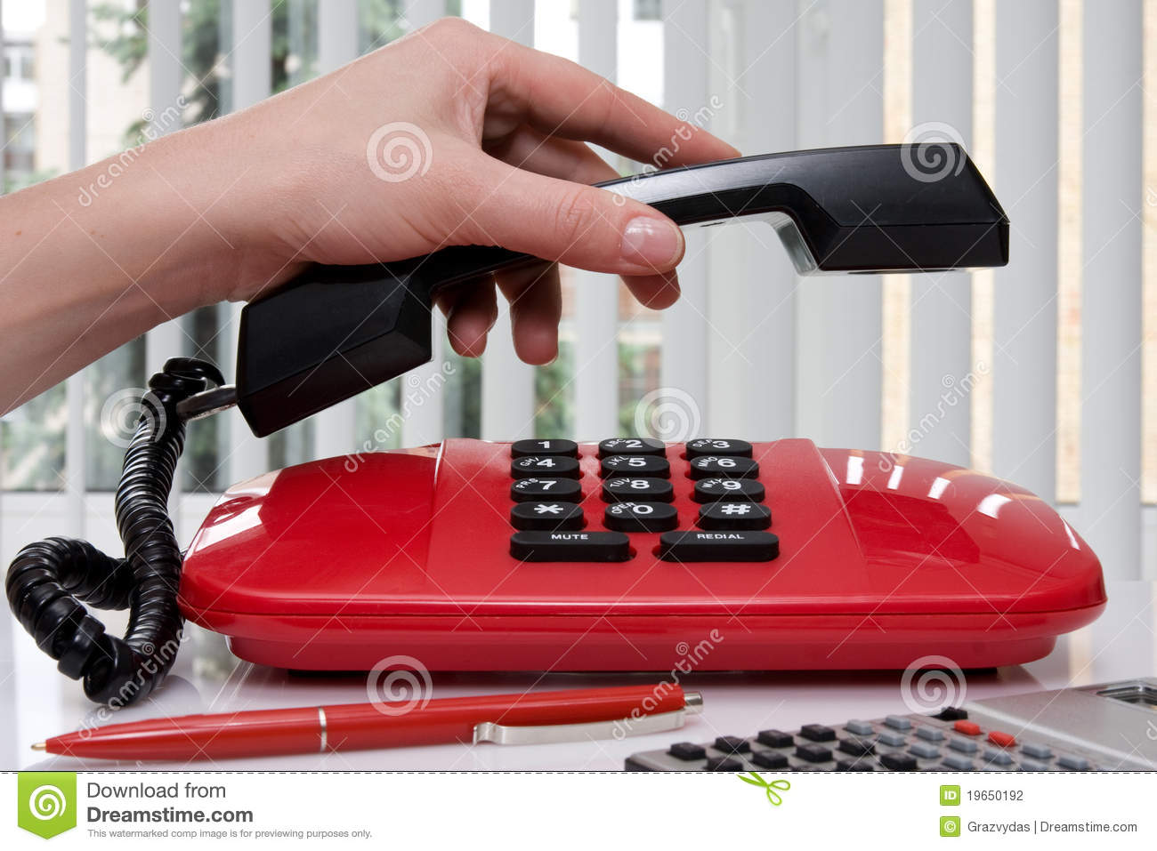 Woman Hand Picking Up The Phone Receiver Stock