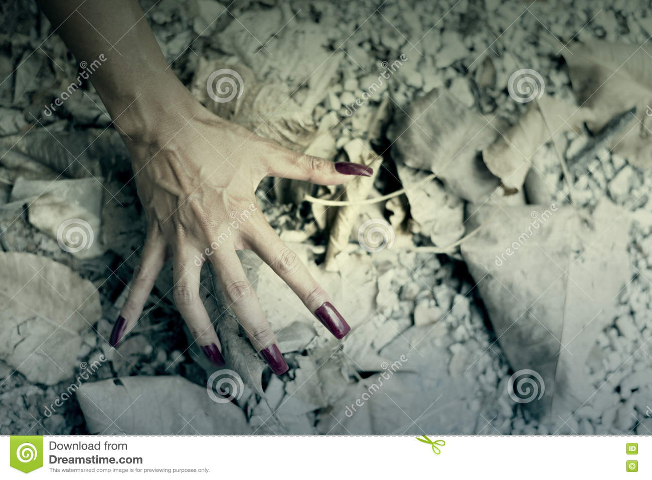 Woman hand step on Floor with Dry leaf.