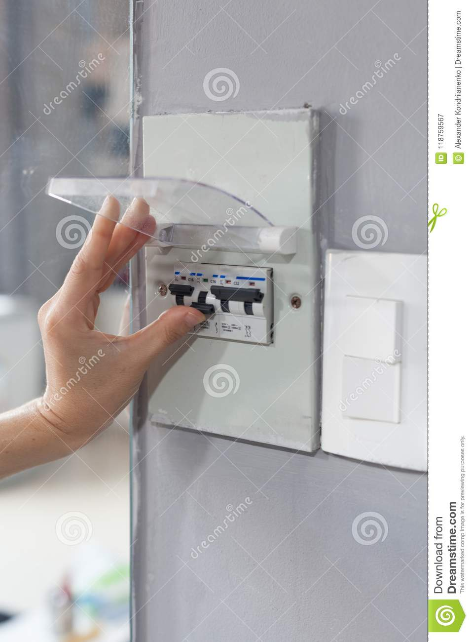 House Fuse Box Trusted Wiring Diagram Woman Hand Turning Off In The Stock Image Of