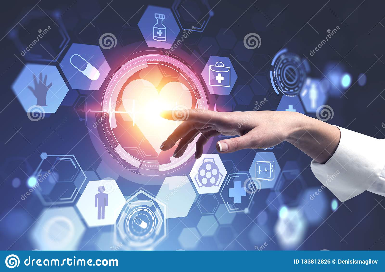 Woman hand using medical interface with heart
