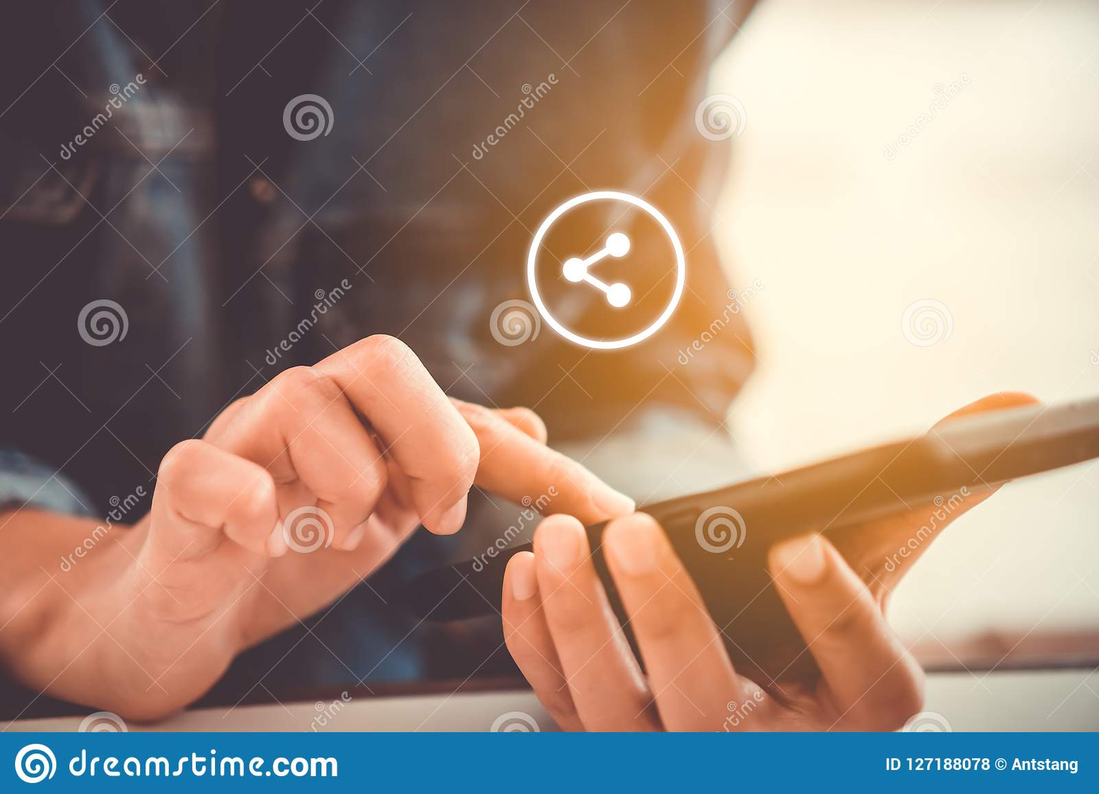 Woman hand using smartphone with share icon.