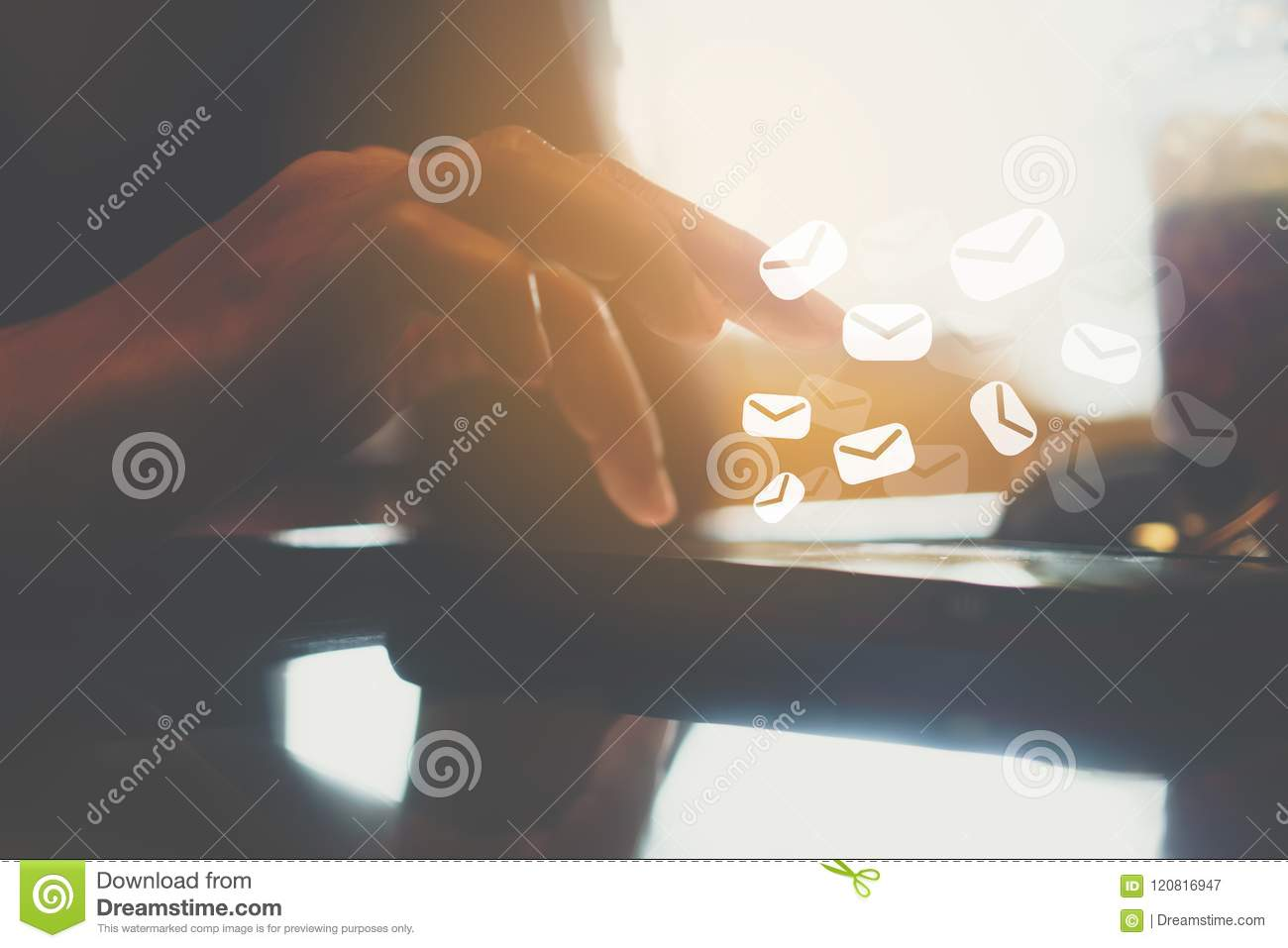 Woman hand using smartphone to send and recieve email for business on nature bokeh background.